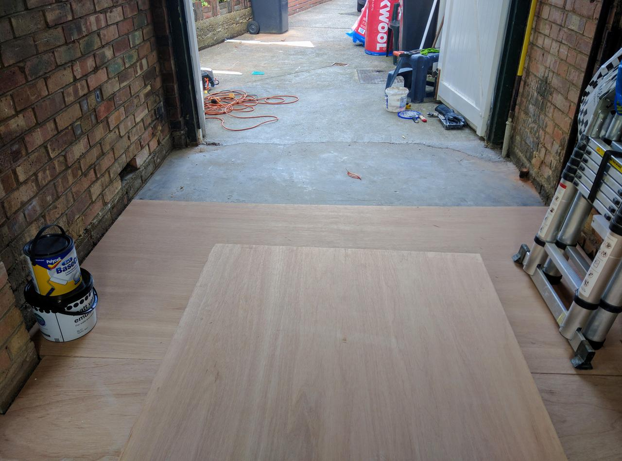 the marine ply floor goes in